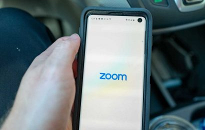 How to change your Zoom background and create your own 'fake room'