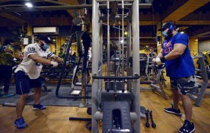 Coronavirus Closes Store Doors, Cuts Fitness Classes by Half