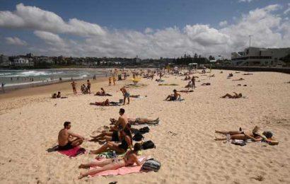 Bondi Beach Crowds Spur Threat of 'Draconian' Virus Controls