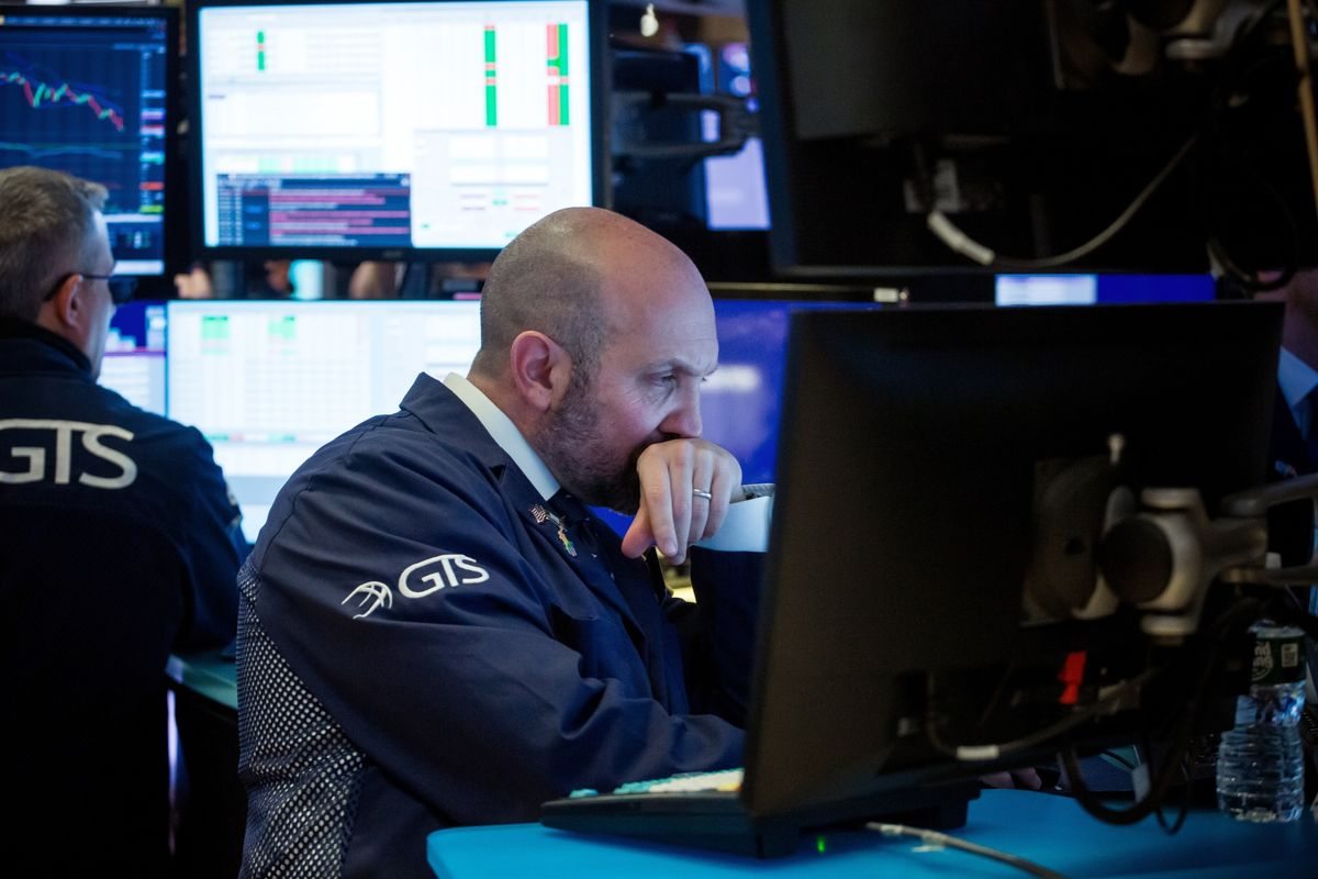 Wall Street Traders Are Tethered to the Desk With Virus Arriving