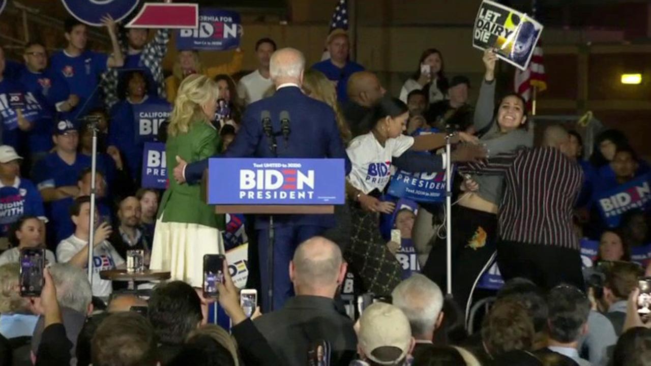 Protesters storm Joe Biden's podium