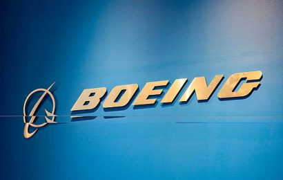 Boeing to ax 10 percent of workers, slow 787 Dreamliner production