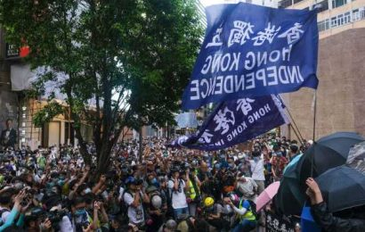 Hong Kong Files First Charges Under New Law, Bans Rallying Cry
