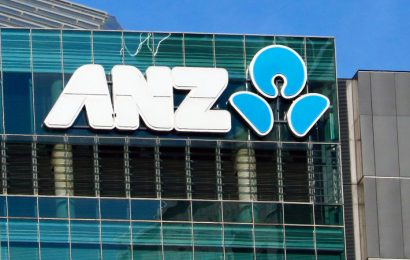 ANZ reports $528m hit to earnings