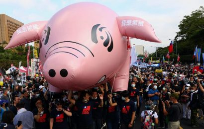 Thousands of people took to the streets of Taiwan to protest against the import of US pork