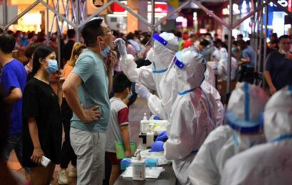 In China's new Covid hotspot, police detain those who violate virus prevention measures