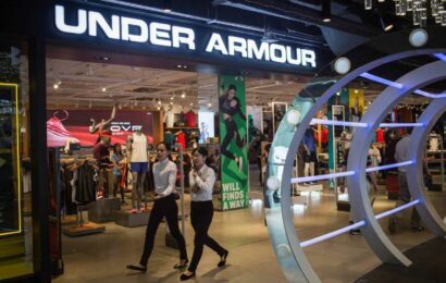 Under Armour shares surge as earnings top estimates, retailer hikes outlook